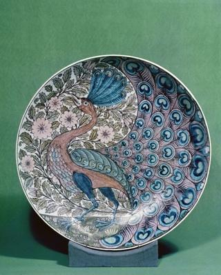 Earthenware dish, painted with a peacock pattern