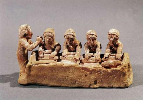 Bakers kneading dough to the sound of a flute, found at Thebes, Boeotia, 6th century BC