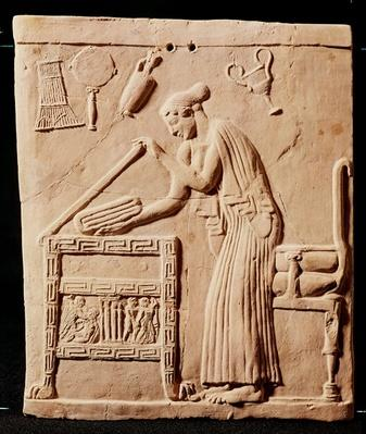 A young woman arranging her clothes in a coffer, 450 BC