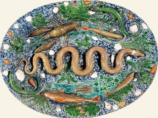 Large oval dish moulded in relief with reptiles and fish