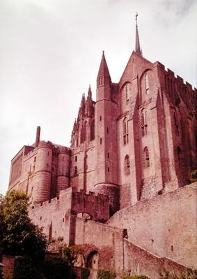 View of the entrance to the Abbey, protected by the barbican, with the Tour des Corbins
