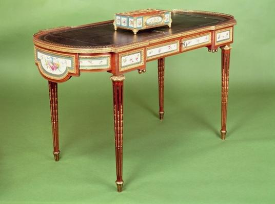 Louis XVI bureau plat with pale tulipwood veneer and shaped ormolu gallery, attributed to Martin Carlin