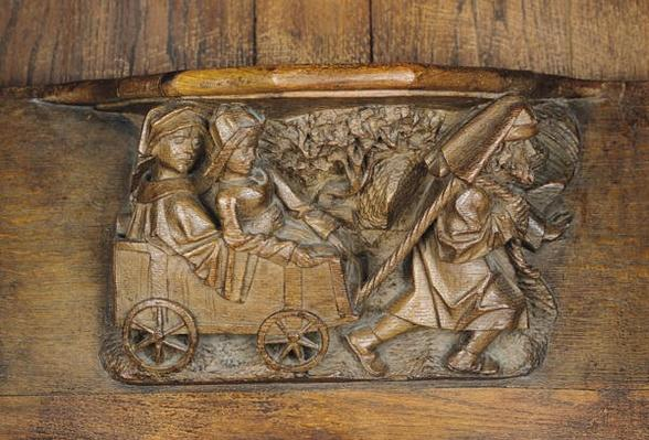 Carving depicting a couple in a cart pulled by a man, from a choir stall