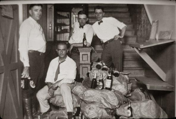 Sheriff's Deputies and Prisoner Pose with Confiscated Liquor | Ken Burns: Prohibition