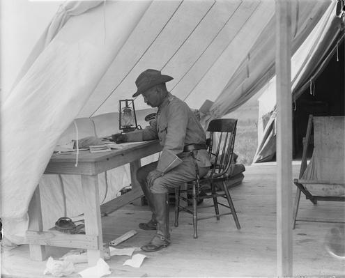 Colonel Roosevelt Writing, Camp Wikoff, NY, 1898 | Ken Burns: The Roosevelts