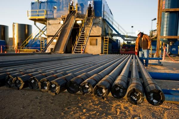 Oil Field Working Inspecting Drilling Pipe | Earth's Resources