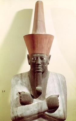 Detail of a statue of Mentuhotep II, enthroned and wearing the red crown of Lower Egypt, taken from the Mortuary Temple of Mentuhotep II, at Deir el-Bahri, Middle Kingdom