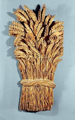 Baker's sign with ears of wheat and flowers of the field