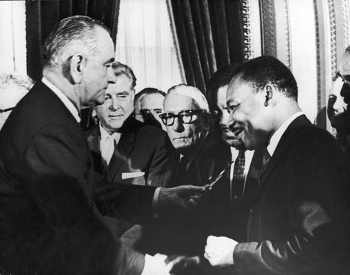 LBJ hands pen to MLK | Civility & Brutality | The 20th Century Since 1945: Civil Rights & the New Millennium