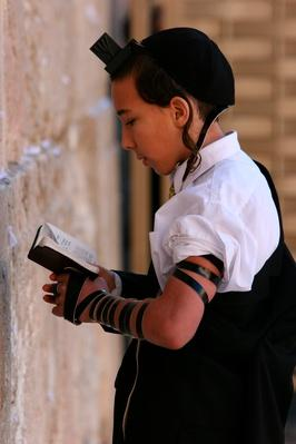Boy praying at the kotel (western wall) | World Religions: Judaism