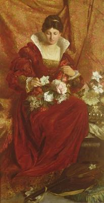 A Lady arranging flowers
