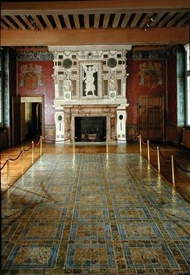 View of the tiled floor and fireplace in the Great Hall