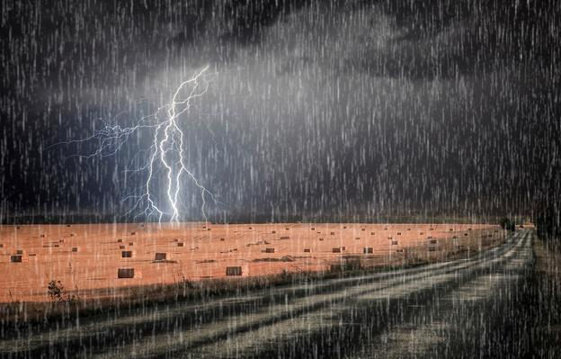 Lightning storm over asphalt road | Weather