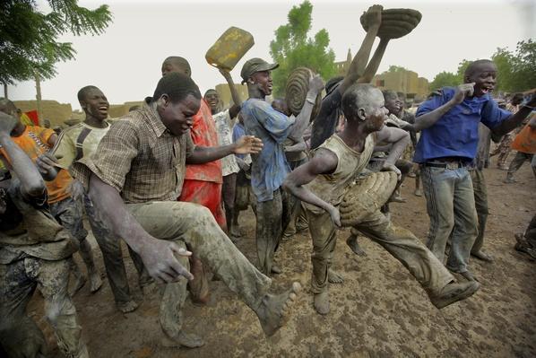 Men dance & celebrate in mud, Djenne, Mali | World Religions: Islam