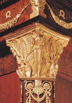 Detail of winged victory from the leg of a secretaire