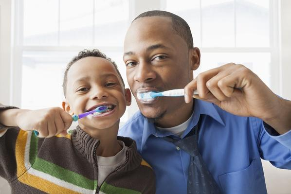 Father and son brushing their teeth | Health and Nutrition
