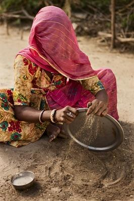 Indian Tribal Woman Washing Dishes With Sand | Earth's Resources