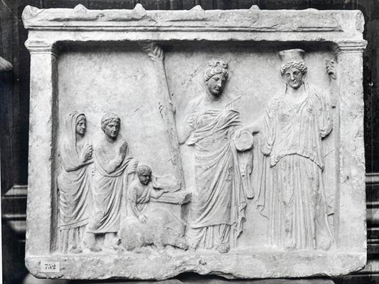 Man, woman and child before an altar offering a sow as a sacrifice to Demeter and Kore