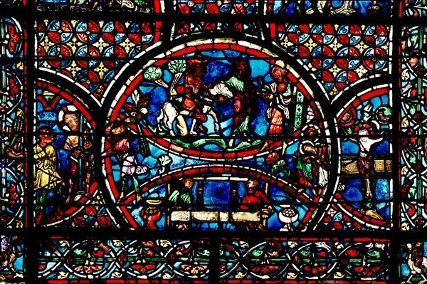 Window depicting the Good Samaritan and the Guild of Weavers