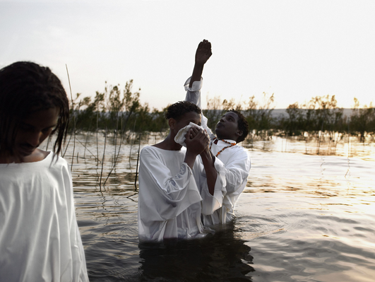 Israel, young man being baptised in Sea of Galilee | World Religions: Christianity