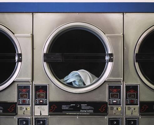Clothes in Laundromat Dryer | Earth's Resources
