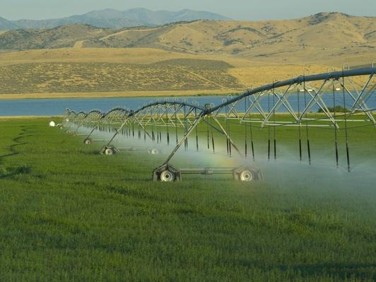 USA, Utah, sprinklers watering farm grass | Human Impact on the Physical Environment | Geography