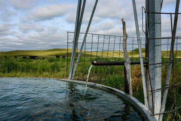 photograph of a windmill pump in the sandhills