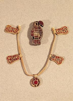 Eagle-shaped brooch and a necklace, 4th-6th century