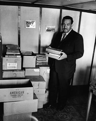 Rev. Francis Griffith Holds Donated Books | African-American History