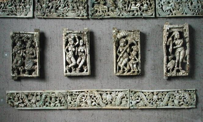 Four plaques depicting feminine figures and two decorative bands, from Begram
