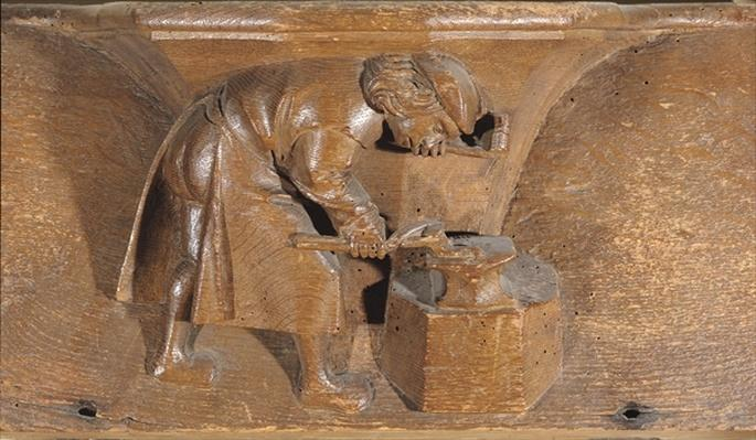Carving depicting a coppersmith, from a choir stall