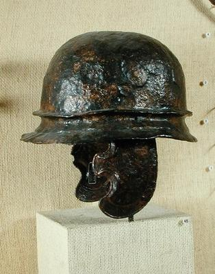 Helmet with cheek guards, from Alesia, Tene III