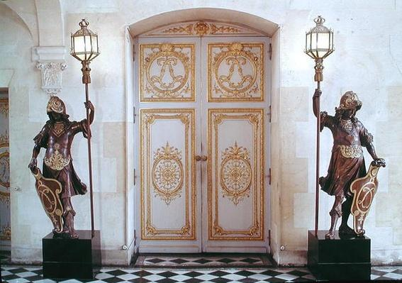 Doors to the vestibule opposite the staircase