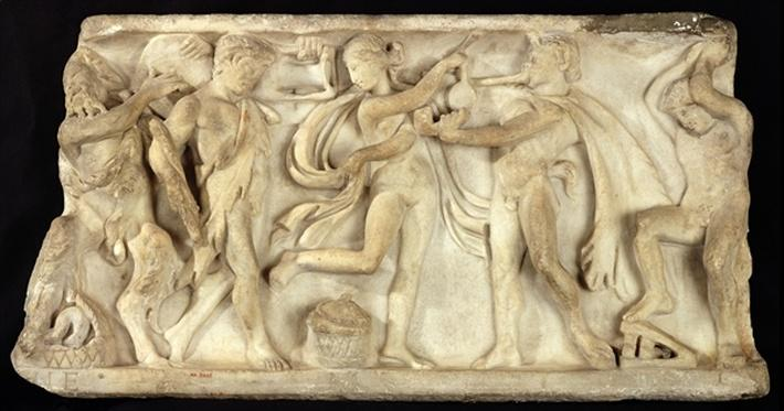 Fragment of a sarcophagus depicting satyrs and a maenad