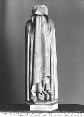 Veiled Mourner, hiding his face behind his veiled hands, from the tomb of Duc Jean de Berry