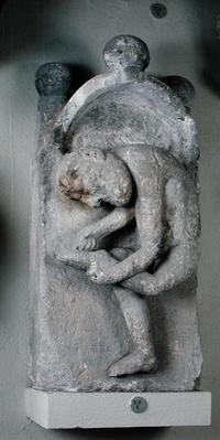 Relief depicting a man removing a thorn from his foot