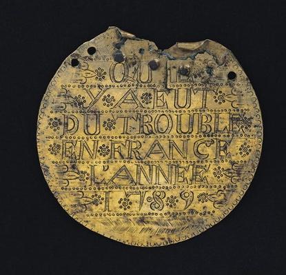 Plaque with the phrase 'Qu'il y a eut du trouble en France l'annee 1789'