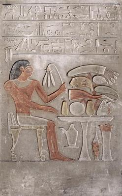 Stela depicting the deceased before an offering table