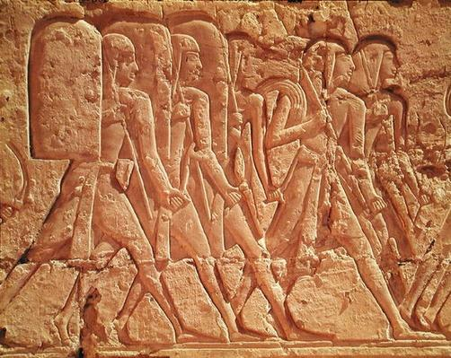 Relief depicting servants carrying rope and weapons, from the Mortuary Temple of Ramesses III