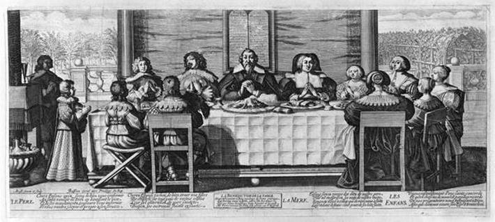 A Protestant family blessing the meal