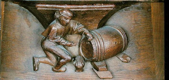 Carving depicting a man putting a tap on a barrel, from a choir stall from the Abbey of St. Lucien in Beauvais