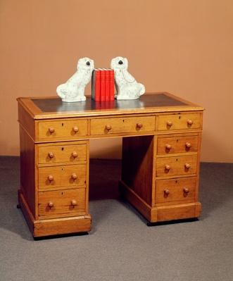 Victorian kneehole desk and a pair of Staffordshire dogs with copper lustre decoration, c.1850