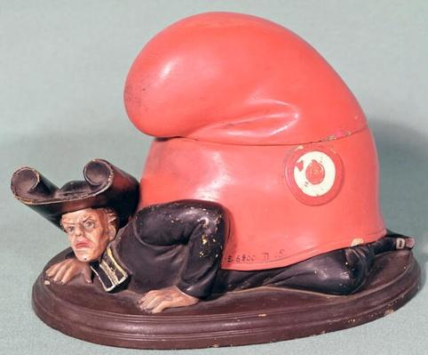 An inkwell or tobacco pot in the form of a priest crushed by a phrygian bonnet, 1870