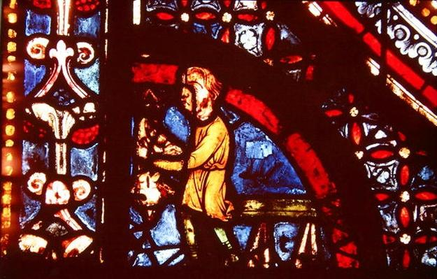 A Butcher, detail from the bottom left hand corner of the Miracles of the Virgin Window in the south aisle of the nave, 1205-15
