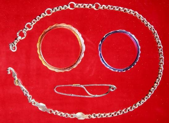 Belt, brooch and two bracelets, Tene II