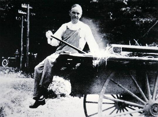 President Calvin Coolidge (1873-1933) posing as a farmer during a vacation in Vermont (b/w photo) by American Photographer, (20th century)