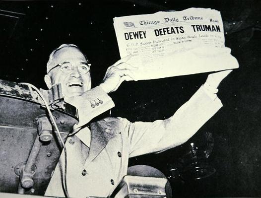 Harry S. Truman (1884-1972) jubilant at newspaper error in the 1948 Presidential election campaign, 1948 (b/w photo) by American Photographer, (20th century)