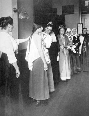 European women undergo medical examination on Ellis Island, New York, c.1900