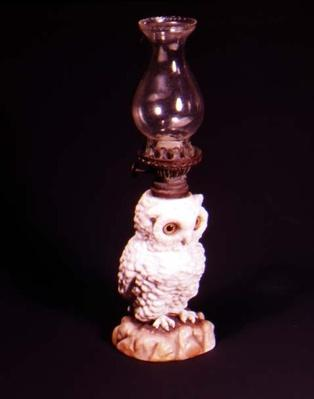 Doulton owl with glass bead eyes on rock work, c.1880
