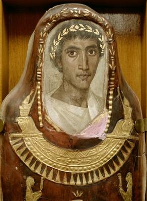 Painted and gilded mummy case of Artemidorus with encaustic portrait in the Hellenistic style, from Hawara